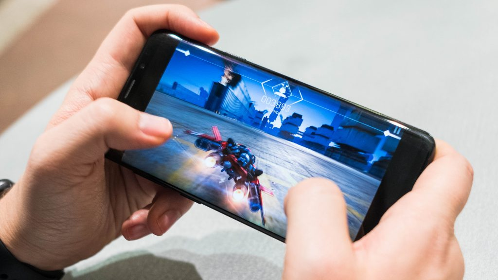 Guy playing online mobile game